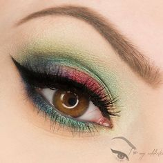 Green and red jewel toned eyeshadow with dramatic winged