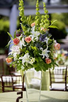 Green and pink floral centerpiece by Bloom! The Art of Flowers