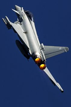 RAF Eurofighter Typhoon II ZK344, display complete and climbing away from RAF Waddington into a clear blue sky.