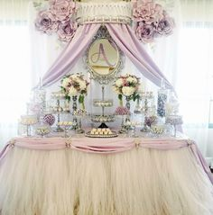 Pretty Dessert Table in lilac, silver and ivory! Decorated with silver chandelier cake stands & sparkling bling created by Opulent Treasures
