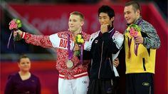 (L-R) Silver medalist Denis Ablyazin of Russia, gold medalist Hak Seon Yang of the Republic of Korea and bronze medalist Igor Radivilov of Ukraine pose on the podium during the Victory Ceremony for the Artistic Gymnastics Men's Vault final on Day 10