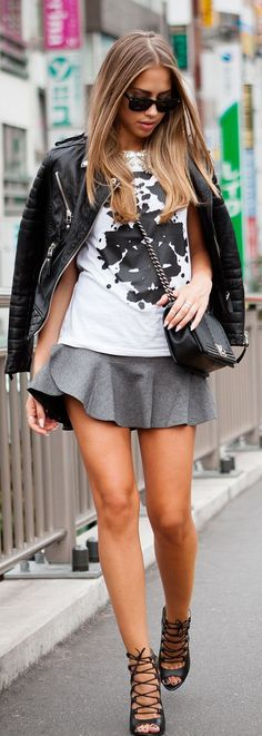 cute: grey flirty skirt, black and white graphic tee, and leather jacket
