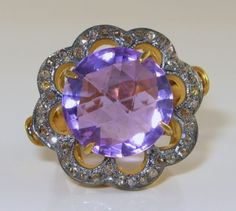Glorious light purple hue to this huge 9 carat Amethyst set in a fleurette shape with 40 Rose Cut Diamonds totaling nearly 1/2 a carat in weight. It is in sterling with gold embellishments. This is a