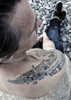 Tattoo of City Map of Paris from 1910 by Mikael Colville-Andersen, via Flickr