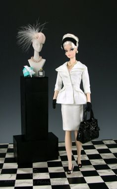 Restyled Verushka in Monogram Incandescent outfit.  Hat by Bogue's Vogues