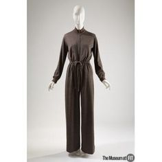 This is a jumpsuit from 1975 and was made in France by Yves Saint Laurent. This is similar to the one from the Rachel Zoe Fall 2017 ready to wear collection. Although the jumpsuits do not look identical, they both have the stitched waist and the flowy bottom pant style. Jumpsuits were popular among designers in the 70s then died down for awhile and now they are something we typically see a lot on the runway.  Lexie Alloway. check date: 4/13