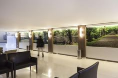 Four 10-foot-long panels show #images of parks and nature in the family waiting area. Mãe de Deus Hospital. Photo: Marcelo Donadussi
