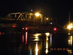 The now torn-down drawbridge at night.