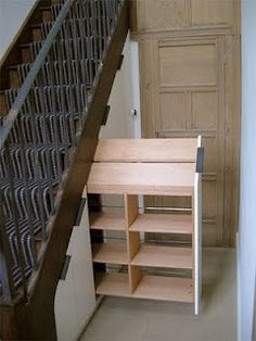 Crazy... under-stair storage... reminds me of those pantries you pull out of a wall...