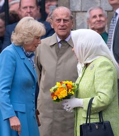 (R-L) Queen Elizabeth II, Prince Philip, Duke of Edinburgh and Camilla, Duchess of Cornwall attend a beacon lighting ceremony to celebrate the Queen's 90th birthday on April 21, 2016 in Windsor, England.