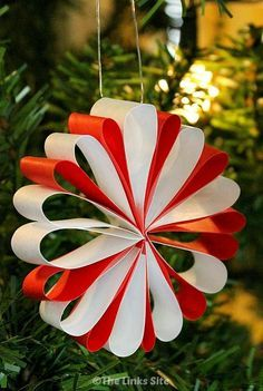 What I love about these paper Christmas decorations is that they look gorgeous but they're really easy to make! thelinkssite.com