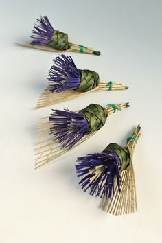 Thistle buttonholes by Flaxation.  www.flaxation.co.nz