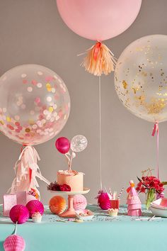 Bright bridal shower decorations idea - pink, gold + peach decor with confetti balloons and bright pompoms {Courtesy of Oh Happy Day}
