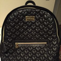 """New Betsey Johnson """"Be Mine"""" Backpack...❤️❤️❤️ The Betsey Johnson Black Quilted """"Be Mine"""" Backpack Zips Around the Top, Inside Zipper,  2 Inside Pouches, Puffy Heart Design. Measures 15""""X14""""X4.5"""", Handle Drop of 4.5"""", Backpack Adjustable Straps... Betsey Johnson Bags Backpacks"""