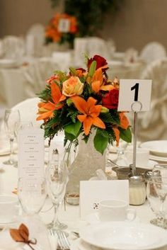 Table Centerpiece for Weddings; Lots of photos to browse of all types of designs, bouquets to centerpieces.  Simple flower arranging lessons.