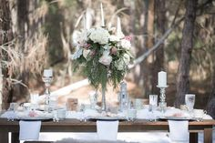 Nutcracker Ballet Styled Wedding Shoot | Outdoor Winter Inspired Wedding Reception with Faux Fur and Wooden Farm Tables with Silver Charger Plates with Vintage China Dishes with Tall Ivory Blush and Pink Floral Centerpieces | Ever After Vintage Weddings Tampa Bay Wedding Rental Company and Event Stylist