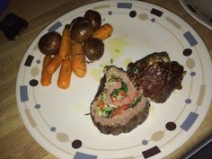 Stuffed flank steak with rosemary carrots and baby potatoes