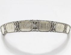 Kokoshnik Tiara. It sold at auction for about 64,000.00 (US). It has 9.0 cts of diamonds and is made in platinum. Origin, Italian.