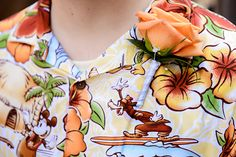 A Disney Hawaiian shirt with a boutonniere is perfect for the casual groom