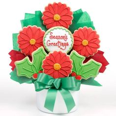 Poinsettia Cutout Bouquet $59.99  All the beauty of traditional flowers but these are edible! This bouquet of poinsettia and holly cutout butter cookies are sweetly glazed and hand decorated. A delicious way to send holiday greetings or use as a table centerpiece.   Ships From OH Delivery (2 -5 Business Days) $14.95