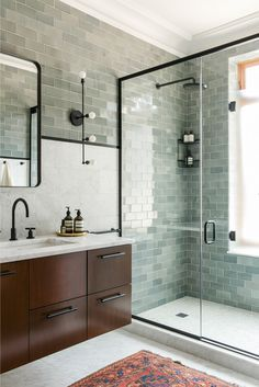 Seafoam Tile covering a shower wall and bathroom! Absolutely lovely :)