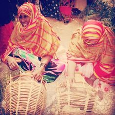 """dynamicafrica: """" nomadfawzi: """" Somali women, wearing the infamous orange & red """"Alindi"""" fabric made in Somalia. The women are weaving a baskets around a milk/water containers. Africa Art, East Africa, Somali Dirac, Camelo, Horn, Blues, Culture, Craft, Red Fabric"""