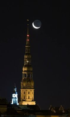 Beautiful view of the St. Peter's Church at night in Riga.