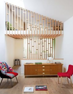 The owner of this house, Virginie, asked three young Chilean architects to transform her banal suburban Parisian home in a refuge open to the light that she has furnished with her vintage finds.
