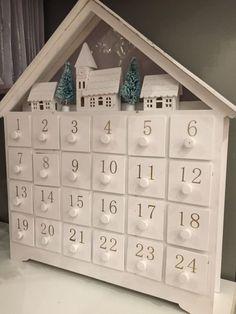 Adorei este calendario de madeira da John Lewis