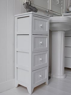 A Crisp White Freestanding Cottage Bathroom Storage Furniture. A Narrow Bathroom  Cabinet With 3 Drawers
