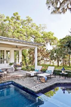 At the heart of every coastal house is an extraordinary setting. Here, along the South Carolina shoreline, a charming Lowcountry cottage compound is modeled after traditional outbuildings, drawing inspiration from its island setting. Originally appeared on Coastal Living