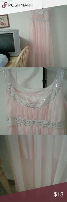 Fancy Long dress Dress is peach color with sequence on the shoulders and the around the tummy area also and those are silver in color. Underneith is a slip half way down the dress only. A beautiful dress. Never been worn. Dresses Maxi