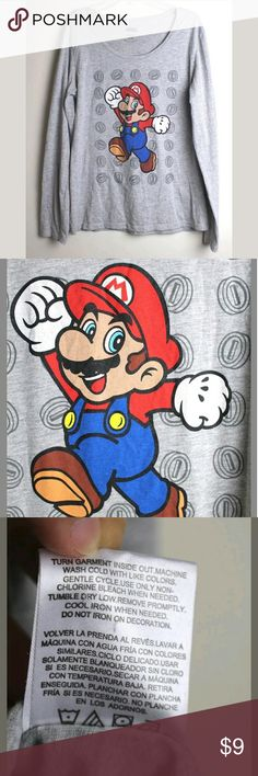 """Super Mario Nintendo t-shirt Super Mario Graphic Nintendo Women's Long sleeves Gray Holiday T-shirt Size L  In great condition. Gently used. No visible rips, stains or tears.  Measurements:  Length: 25"""" Sleeve: 23.5"""" Armpit To armpit: 18.5"""" Nintendo Tops Tees - Long Sleeve"""