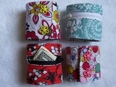 "Wrist Wallet - The only changes I made was using interfacing to back the entire exposed front panel. It adds a little more stability. I also made two button closures on each one rather than the Velcro-it's what I had on hand. I couldn't find any zippers shorter than 12"", so I just measured how much I needed and stitched back and forth at that point to create the right length. Then, just trimmed off the excess. http://alemonsqueezyhome.blogspot.com/2010/09/lunch-money-cuff-tutorial.html"