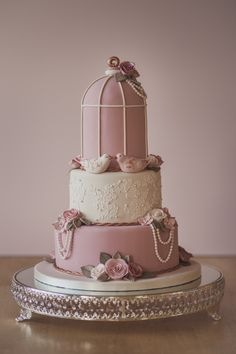 Pretty birdcage cake that I did for a wedding recently. Time lapse of the making of it can be found here:  https://vimeo.com/215385718