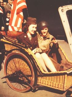 The transportation problem has been unusually hard on the French civilians. Bicycles are the main means. Here are two Americans seeing Paris...