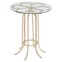 Glass-top end table with an iron base and blossom-inspired accent.    Product: End tableConstruction Material: ...