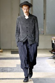 See the complete Yohji Yamamoto Spring 2012 Menswear collection.