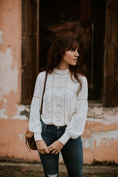 white embroidered blouse and jeans