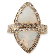 Pyramid triangle ring with large opal and diamonds, $2,665; Jacquie Aiche