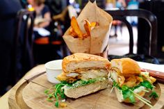 Softshell crab sandwich with ramp tartar sauce and pea shoots at The Breslin / photo by Adam Goldberg