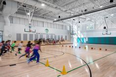 Image 24 of 25 from gallery of Woodland Elementary School / HMFH Architects. Courtesy of HMFH Architects Primary School Education, Elementary Schools, Gym Design, School Design, The New School, Middle School, Home Basketball Court, Gym Interior, Interior Paint