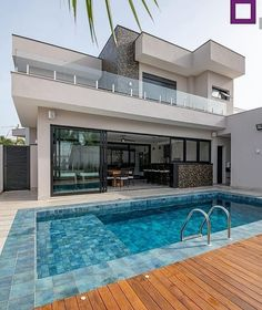 Large outdoor area, beautifully lined swimming pool, gourmet area and deck. House Design, Future House, House, House Goals, House Architecture Design, House Exterior, House Styles, Exterior Design, Modern House Exterior
