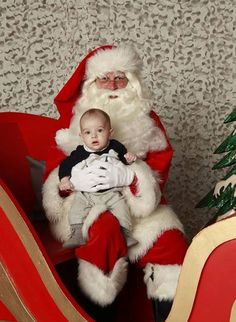 His Royal Cuteness! Princess Madeleine's baby son Nicolas meets Santa for the first time - Photo 1