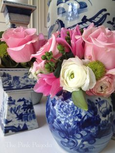 Isn't this blue and white porcelain jar  filled with a pink, green and white bouquet fabulous???