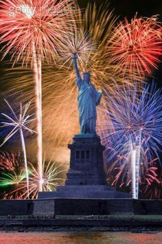 The iconic symbol of America, the Statue of Liberty stands on Liberty Island New York Harbor & is a national monument