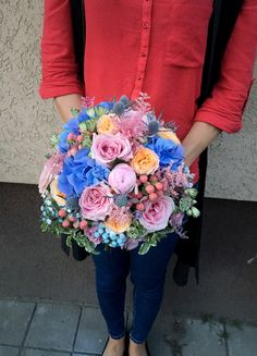 Bride bouquet, blue, peach and pink