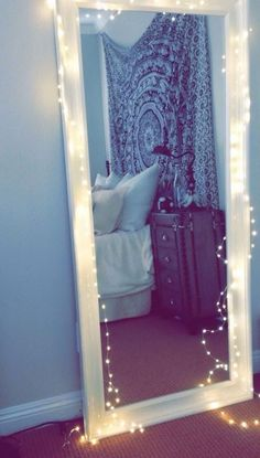 Lights around your mirror are awesome ways to decorate your dorm room!