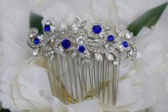 This is a gorgeous piece of swarovski crystal rhinestone jewelry that has been added to a silver hair comb. All of the stones in this piece are