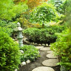 Japanese gardens combine the basic elements of plants, water, and rocks with simple, clean lines to create a tranquil retreat. Here a winding path leads your eye past the stone pagoda and beckons exploration of what's around the next corner.